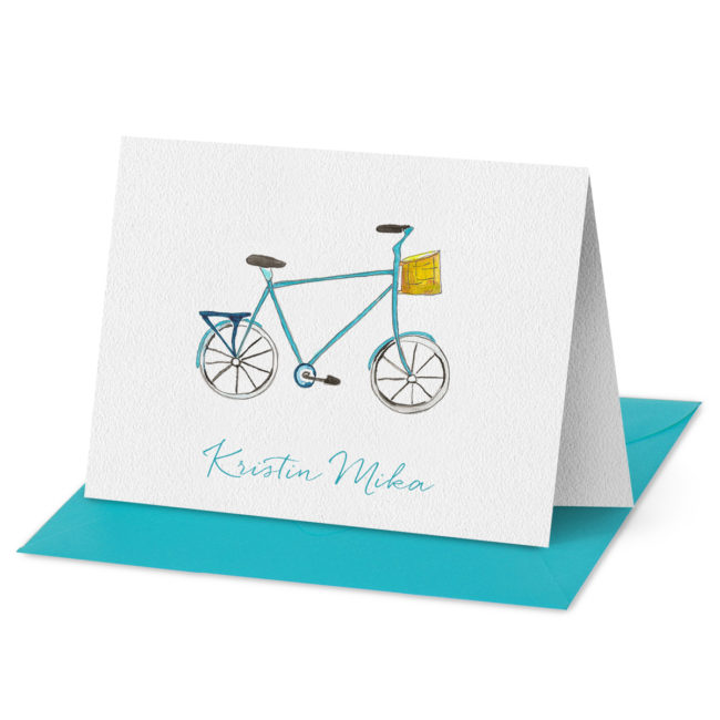 Folded Note Card featuring a bicycle printed on white paper.