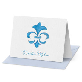 Folded Note Card featuring a blue fleur de lis image printed on white paper.