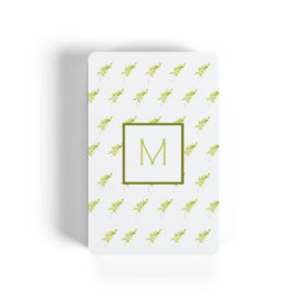 fern motif adorns playing cards