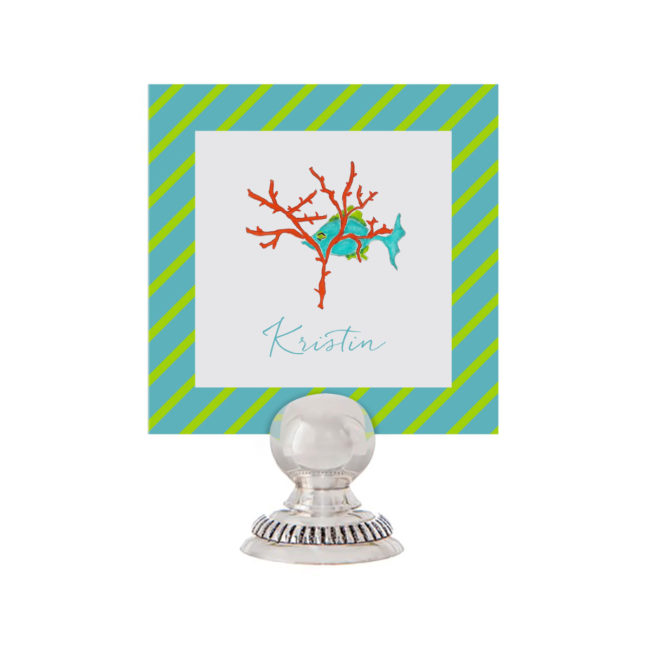 fish with coral placecard printed on White paper.