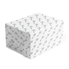 classic gift wrap with silver key image printed on white paper.
