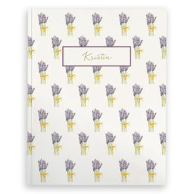 lavender image adorns a journal with blank pages.