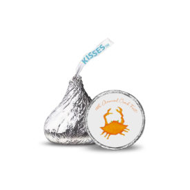 orange crab image printed on a candy sticker that fits on the bottom of a Hershey's kiss.