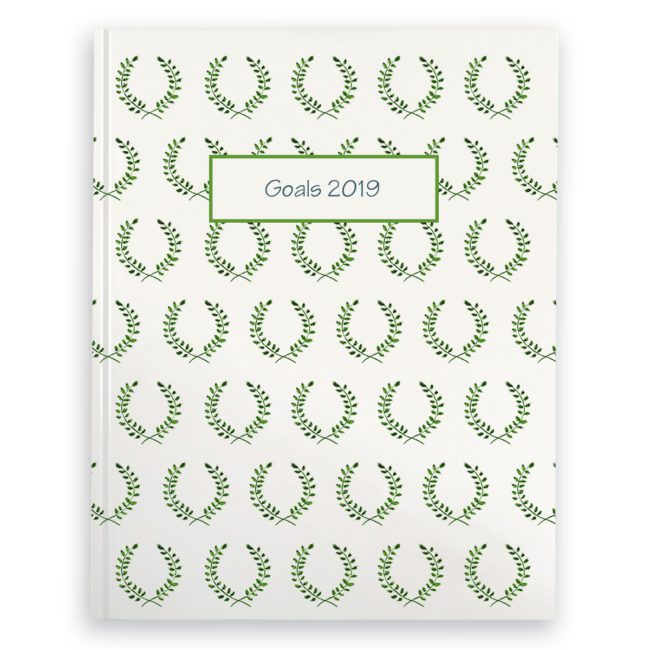 Laurel image adorns a journal with blank pages.