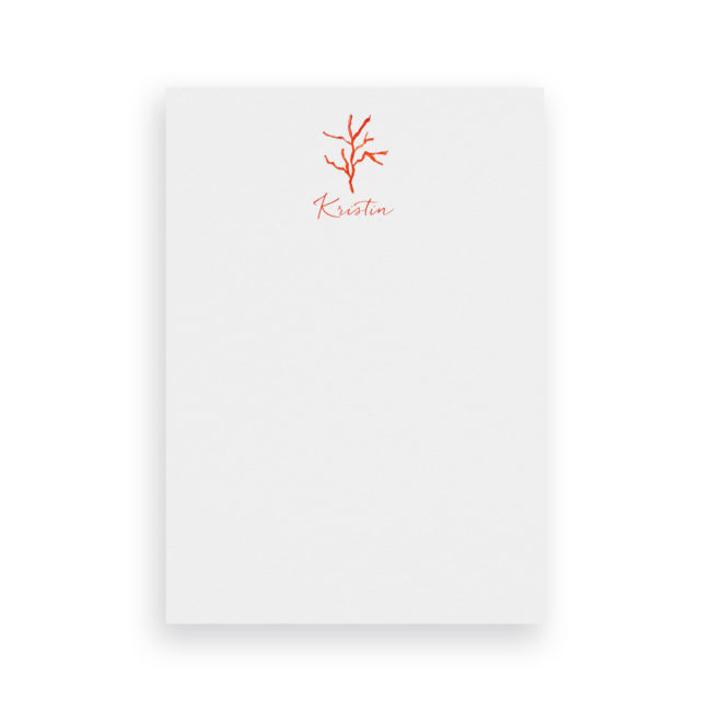 red coral classic notepad printed on White paper.