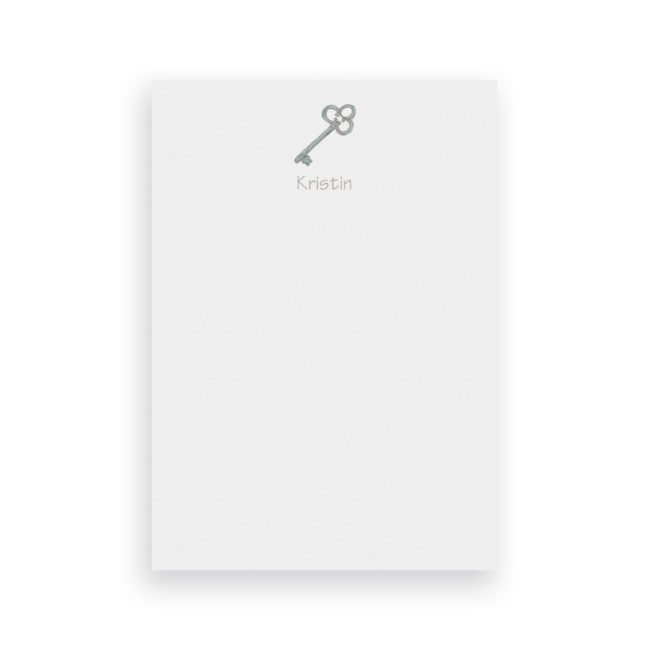 key classic notepad printed on White paper.