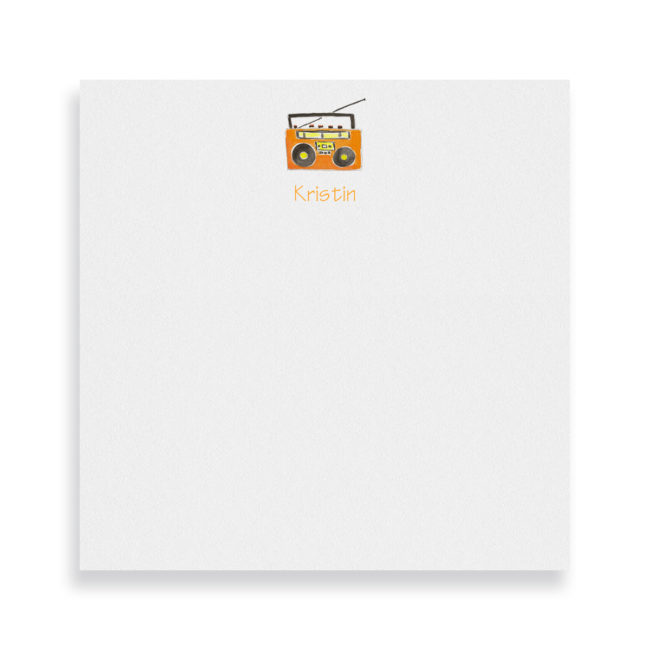 boom box image adorns a square notepad printed on white paper.