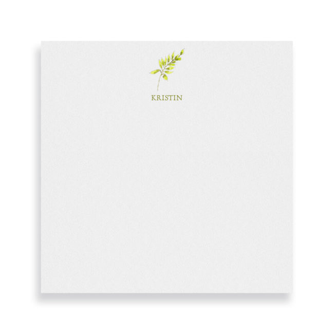 fern image adorns a square notepad printed on white paper.