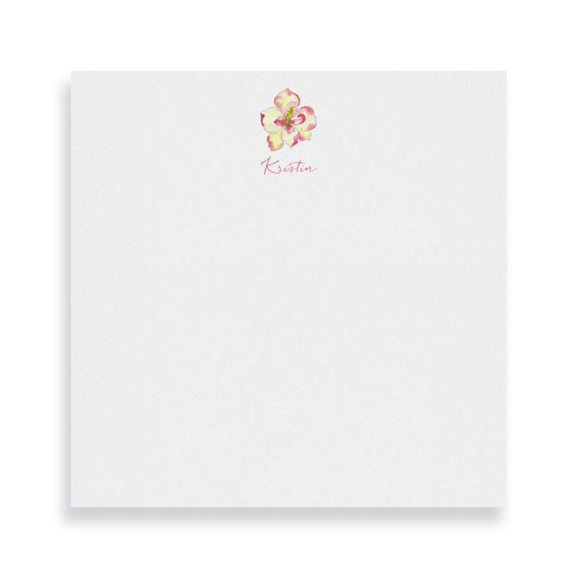 magnolia image adorns a square notepad printed on white paper.