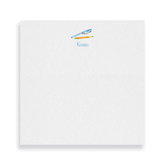 pen and pencil image adorns a square notepad printed on white paper.