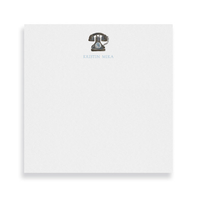 vintage phone image adorns a square notepad printed on white paper.
