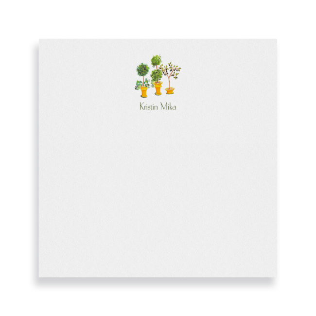 topiaries tree image adorns a square notepad printed on white paper.