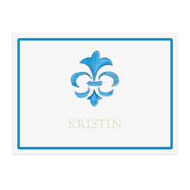 Fleur de Lis image adorns a paper placemat printed on White paper.