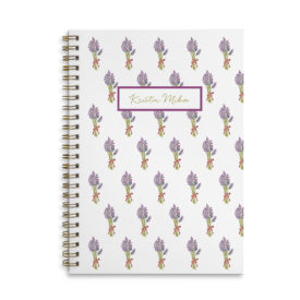 lavender spiral bound notebook with blank pages.