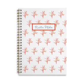 Red Coral Spiral Notebook with blank pages.