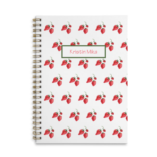 Image of strawberries adorns a spiral bound notebook with blank pages.