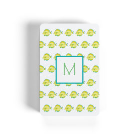 yellow fish motif adorns playing cards