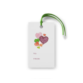 Hearts image on a gift tag that is glittered.