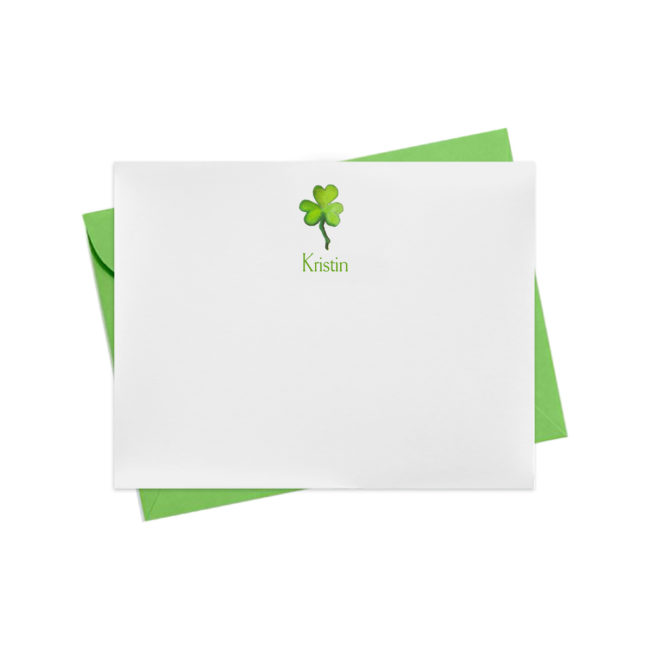 Flat white notecard with a green shamrock image that can be personalized printed on white paper.