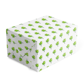 Gift wrap on white paper featuring a green shamrock image.