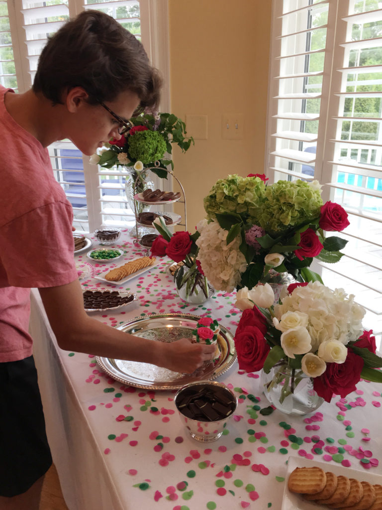 My son Thomas creating a dessert table.
