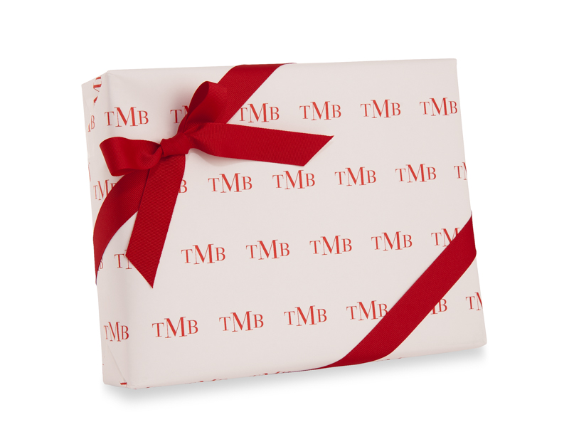 Holiday gift wrap with a monogram.