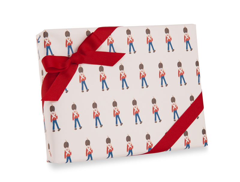 Holiday gift wrap featuring a toy soldier.