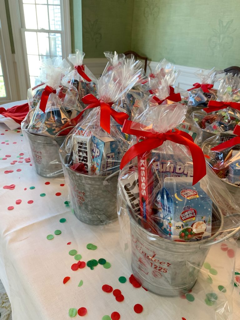 Photo showing party favors of silver buckets filled with candy.